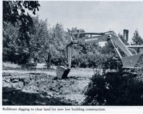Boyd Law Building - Bulldozer digging to clear land for new law building construction.