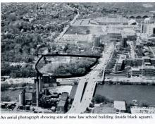 An aerial photograph showing site of new law school building (inside black square).